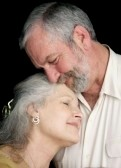 868464-a-beautiful-middle-aged-couple-tenderly-embracing-eachother--they-are-very-much-in-love--black-backg